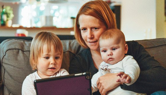 Mom working from home with two kids